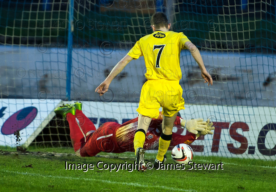 Queen of the South's Paul Burns scores their first goal after Cowdenbeath keeper Grant Adam fumbles the ball.