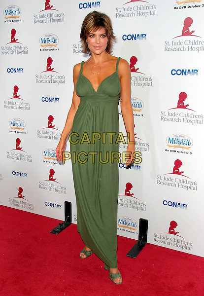 LISA RINNA.Attends Runway for Life, Benefiting St. Jude Children's Research Hospital held at The Beverly Hilton Hotel in Beverly Hills, California, USA, September 15th 2006..full length green dress.Ref: DVS.www.capitalpictures.com.sales@capitalpictures.com.©Debbie VanStory/Capital Pictures