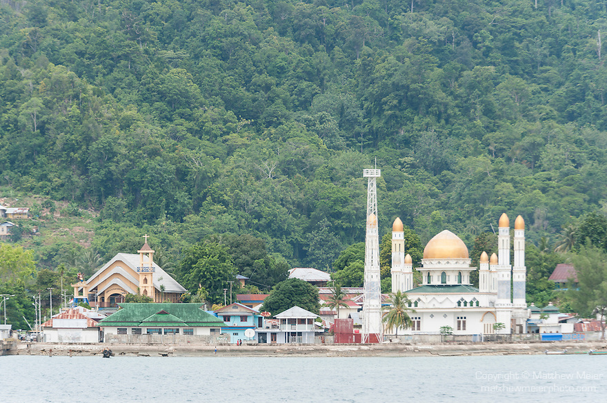 Kaimana, West Papua, Indonesia; view of a mosque near the harbor of Kaimana while sailing into port to refuel