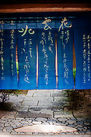 A blue noren curtain hangs at a Kyoto gateway.
