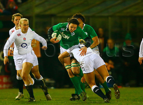 27.02.2015. Ashbourne Rugby Club, Ireland. Womens 6-Nations international. Ireland versus England. Paula Fitzpatrick (Ireland) is tackled by Alexandra Matthews (England).