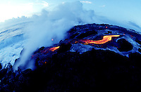 Lava enters the ocean creating an explosion of steam at Volcanoes National Park on the Big Island of Hawaii.