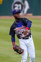 Cedar Rapids Kernels outfielder Akil Baddoo (24) warms up prior to a Midwest League game against the Kane County Cougars on April 21, 2018 at Perfect Game Field at Veterans Memorial Stadium in Cedar Rapids, Iowa. Kane County defeated Cedar Rapids 9-2. (Brad Krause/Four Seam Images)