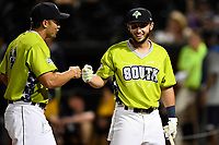 Michael Paez of the Columbia Fireflies, right, is greeted by manager Jose Leger after finishing as a finalist in the Home Run Derby as part of the South Atlantic League All-Star Game festivities on Monday, June 19, 2017, at Spirit Communications Park in Columbia, South Carolina. (Tom Priddy/Four Seam Images)