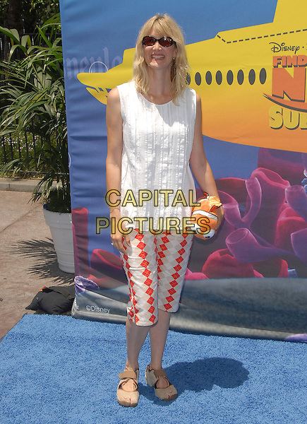 LAUREA DERN.attends The Finding Nemo Submarine Voyage Celebrity Preview held in Tomorrowland at Disneyland in Anaheim, California, USA, June 10 2007                                                                     full length white top tunic beige trainer shoes.CAP/DVS.©Debbie VanStory/Capital Pictures