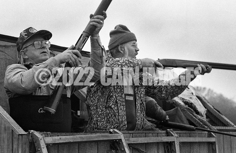 Ron Kobli, left, loads his gun as Herb Booth shoots at a goose Saturday November 2, 1991 in Buckingham, Pennsylvania. (Photo by William Thomas Cain)