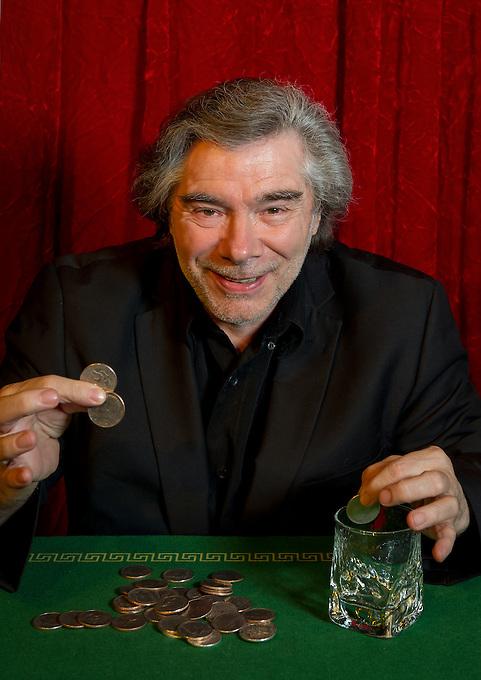 Jean-Pierre Crispon performing with coins during a photo-shoot for publicity purposes at the Double Fond, café-théatre de la magie (café and magic theatre), at 1, place du Marché Ste Catherine, 75004 Paris.
