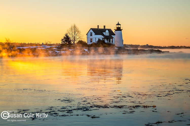 Sea smoke at sunrise at  Prospect Harbor Light in Prospect Harbor, Gouldsboro, Maine, USA