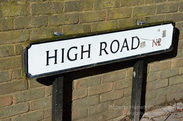 High Road N2 street sign, East Finchley, London, UK.