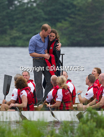 "PRINCE WILLIAM HUGS KATE.after winning the Dragonboat race, Dalvey Lake, Dalvey-by-Sea, Prince Edward Island_04/07/2011.Mandatory Credit Photo: ©DIAS-DIASIMAGES..**ALL FEES PAYABLE TO: ""NEWSPIX INTERNATIONAL""**..IMMEDIATE CONFIRMATION OF USAGE REQUIRED:.DiasImages, 31a Chinnery Hill, Bishop's Stortford, ENGLAND CM23 3PS.Tel:+441279 324672  ; Fax: +441279656877.Mobile:  07775681153.e-mail: info@newspixinternational.co.uk"
