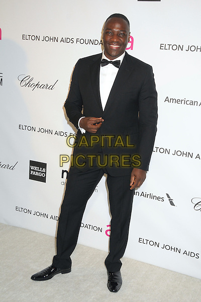 Adewale Akinnuoye-Agbaje.21st Annual Elton John Academy Awards Viewing Party held at West Hollywood Park, West Hollywood, California, USA..February 24th, 2013.oscars full length black white bow tie shirt tuxedo.CAP/ADM/BP.©Byron Purvis/AdMedia/Capital Pictures.
