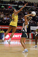 25.10.2012 Australia's Mo'onia Gerrard and South Africa's Maryka Holzhausen in action during the England v Australia netball test match as part of the Quad Series played at the TSB Arena Wellington. Mandatory Photo Credit ©Michael Bradley.