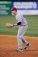 First baseman Matt Hink (42) of the Harvard Crimson in a game against the Michigan State Spartans on Saturday, March 15, 2014, at Fluor Field at the West End in Greenville, South Carolina. Michigan State won, 4-0. (Tom Priddy/Four Seam Images)