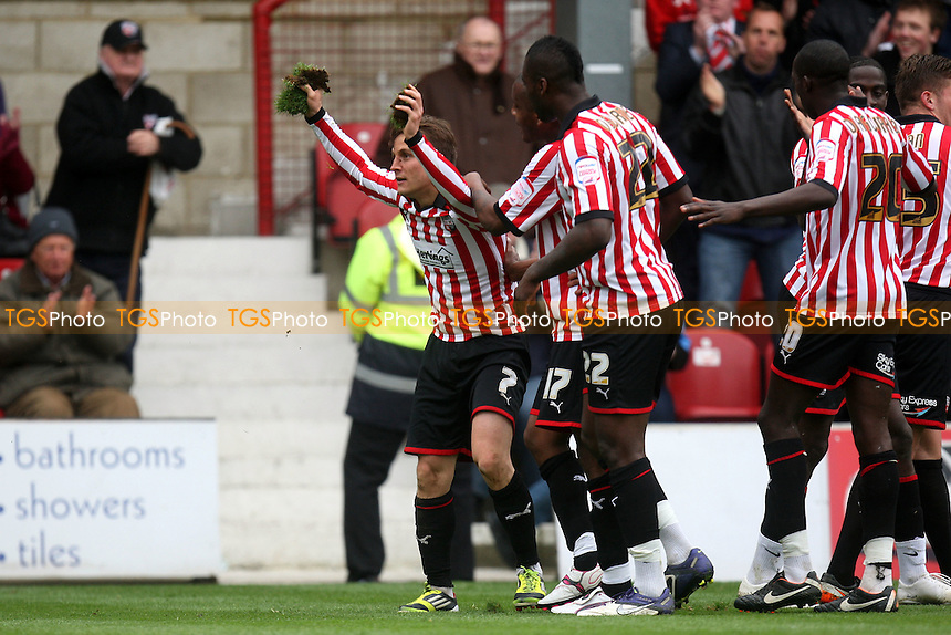 Sam Saunders of Brentford celebrates scoring the second goal -  Brentford vs Bury - at the Griffin Park Stadium - 07/04/12 - MANDATORY CREDIT: Dave Simpson/TGSPHOTO - Self billing applies where appropriate - 0845 094 6026 - contact@tgsphoto.co.uk - NO UNPAID USE.