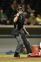 Umpire Carlos Torres makes a call during an Arizona Fall League game between the Salt River Rafters and Mesa Solar Sox on October 18, 2014 at Cubs Park in Mesa, Arizona.  Mesa defeated Salt River 8-4.  (Mike Janes/Four Seam Images)