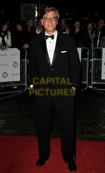 AARON SORKIN.London Critics' Circle Film Awards at BFI Southbank, London, England..February 10th 2011.ALFS full length black white bow tie tuxedo glasses hands in pockets .CAP/CAN.©Can Nguyen/Capital Pictures.