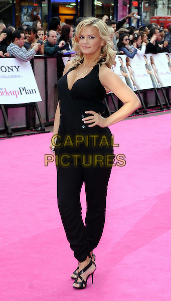 """KERRY KATONA.At the Gala Film Premiere of """"The Back-Up Plan"""", The Vue, Leicester Square, London, England, UK, 28th April 2010. .arrivals full length black halterneck catsuit jumpsuit hand on hip cleavage low cut boobs tanned strappy open toe sandals.CAP/DS.©Dudley Smith/Capital Pictures"""