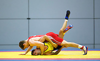 11 MAY 2014 - SHEFFIELD, GBR - Philip Roberts (top, in red) attempts to pin his opponent during their men's 66kg category freestyle match at the British 2014 Senior Wrestling Championships in EIS in Sheffield, Great Britain (PHOTO COPYRIGHT © 2014 NIGEL FARROW, ALL RIGHTS RESERVED)