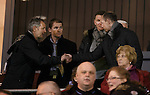 Kenny Black greets Allan Johnston as Alan Archibald and Martin Hardie take their seats in the stands