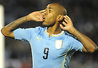 MONTEVIDEO - URUGUAY -13-10-2015: Diego Rolan, jugador de Uruguay celebra el gol anotado a Colombia, durante partido de la fecha 2 válido entre Uruguay y Colombia por la clasificación a la Copa Mundo FIFA 2018 Rusia jugado en el estadio Centenario de la ciudad de Montevideo. /  Diego Rolan, player of Uruguay celebrates a scored goal to Colombia during match between Uruguay and Colombia, for the date 2 for the 2018 FIFA World Cup Russia Qualifier played at Centenario Stadium in Montevideo city. Photo: Photosport / VizzorImage / Dante Fernandez / Cont.