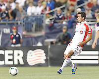 Toronto FC forward Andrew Wiedeman (32) passes the ball.  In a Major League Soccer (MLS) match, Toronto FC (white/red) defeated the New England Revolution (blue), 1-0, at Gillette Stadium on August 4, 2013.