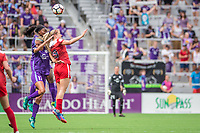 Orlando, FL - Saturday April 22, 2017: Dani Weatherholt, Kristie Mewis during a regular season National Women's Soccer League (NWSL) match between the Orlando Pride and the Washington Spirit at Orlando City Stadium.