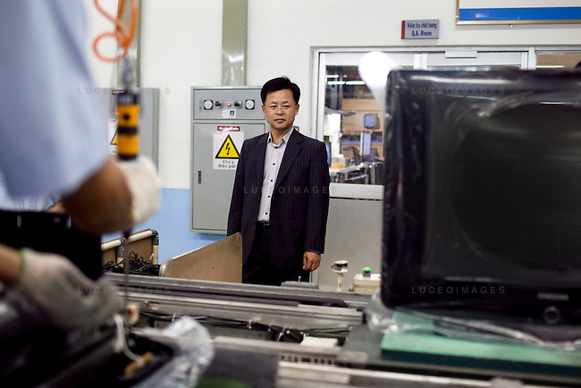 Je Hyoung Park, President of Samsung vina Electronics Co., watches the contrustion of CRT television sets at the Samsung Vina Electronics Co. factory in district Thu Duc in Ho Chi Minh City, Vietnam. Photo taken on Friday, December 4, 2009. Kevin German / Luceo Images