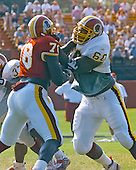 Washington Redskins defensive end Bruce Smith (78) and offensive tackle Chris Samuels (60) participate in drills against one another at the team's training camp at Redskins Park in Ashburn, Virginia on August 10, 2000.<br /> Credit: Arnie Sachs / CNP