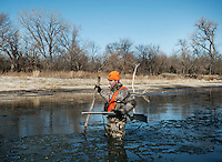 Andrew McKean in search of an injured deer during a hunt for white tail deer in Superior, Nebraska. Shot for Outdoor Life Magazine.