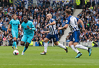 Tottenham Hotspur's Tanguy Ndombele (centre) under pressure from Brighton & Hove Albion's Neal Maupay (centre right) and Dale Stephens (right) <br /> <br /> Photographer David Horton/CameraSport<br /> <br /> The Premier League - Brighton and Hove Albion v Tottenham Hotspur - Saturday 5th October 2019 - The Amex Stadium - Brighton<br /> <br /> World Copyright © 2019 CameraSport. All rights reserved. 43 Linden Ave. Countesthorpe. Leicester. England. LE8 5PG - Tel: +44 (0) 116 277 4147 - admin@camerasport.com - www.camerasport.com