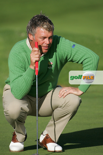 Straffin Co Kildare Ireland. K Club Ruder Cup...European Ryder cup team members Darren Clarke lining up his putt on the forth  green during the opening fourball session of the first day of the 2006 Ryder Cup, at the K Club in Straffan, Co Kildare, in the Republic of Ireland, 22 September 2006..Photo: Fran Caffrey/ Newsfile..