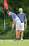 Garett Zurliene (left) of the SIGA eClub sinks a putt on the third hole as Luke McLaughlin with the Bellerive Country Club watches. They were among about 50 golfers competing on the first day of the Metropolitan Amateur Golf Association's 20th Junior Amateur Championship being held at the St. Clair Country Club in Belleville, IL on July 1, 2019. <br /> Tim Vizer/Special to STLhighschoolsports.com
