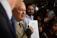 Representative Dana Rohrabacher, Republican of California, talks to reporters following a meeting of United States House of Representatives Republican members in the basement of the United States Capitol Building on June 7, 2018 in Washington, DC. The Republican members are discussing immigration policy changes. <br /> CAP/MPI/RS<br /> &copy;RS/MPI/Capital Pictures