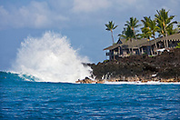 Unusual high surf in leeward, Kona, crashing on lava rocks and thrreatening luxury condominiums behind, Keauhou Bay, Kona Coast, Big Island, Hawaii, Pacific Ocean.