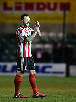Lincoln City's Neal Eardley applauds the fans at the final whistle<br /> <br /> Photographer Chris Vaughan/CameraSport<br /> <br /> The EFL Sky Bet League Two - Lincoln City v Cheltenham Town - Tuesday 13th February 2018 - Sincil Bank - Lincoln<br /> <br /> World Copyright &copy; 2018 CameraSport. All rights reserved. 43 Linden Ave. Countesthorpe. Leicester. England. LE8 5PG - Tel: +44 (0) 116 277 4147 - admin@camerasport.com - www.camerasport.com