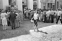 ROMANIA, Mosilor Av., Bucharest, 08.1981.Four queues for eggs, and a young lady in the sunshine..© Andrei Pandele / EST&OST
