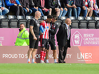 Lincoln City manager Danny Cowley speaks to Lincoln City's Bruno Andrade before he is introduced as a second half substitute<br /> <br /> Photographer Chris Vaughan/CameraSport<br /> <br /> The EFL Sky Bet League One - Lincoln City v Fleetwood Town - Saturday 31st August 2019 - Sincil Bank - Lincoln<br /> <br /> World Copyright © 2019 CameraSport. All rights reserved. 43 Linden Ave. Countesthorpe. Leicester. England. LE8 5PG - Tel: +44 (0) 116 277 4147 - admin@camerasport.com - www.camerasport.com