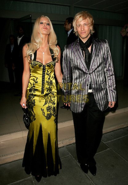 EMMA NOBLE & RICK PARFITT.The Laurent-Perrier Pink Party, Suka, Sanderson Hotel, London, England..April 25th, 2007.full length black floral print green satin dress trousers grey gray striped stripes jacket couple kiss puckering.CAP/AH.©Adam Houghton/Capital Pictures