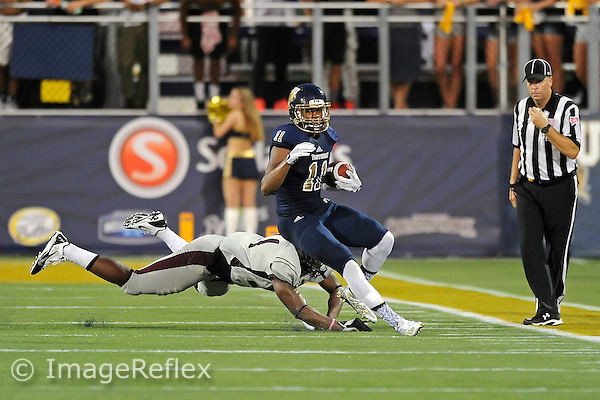 19 September 2015:  FIU tight end Akil Dan-Fodio (11) attempts to break away from NC Central defensive lineman Richard Mitchell (91) in the second half as the FIU Golden Panthers defeated the North Carolina Central University Eagles, 39-14, at FIU Stadium in Miami, Florida.