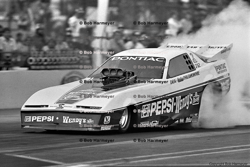 "POMONA, CALIFORNIA: Don ""The Snake"" Prudhomme drives his Pontiac Funny Car during a 1985 NHRA drag race at Pomona, California."
