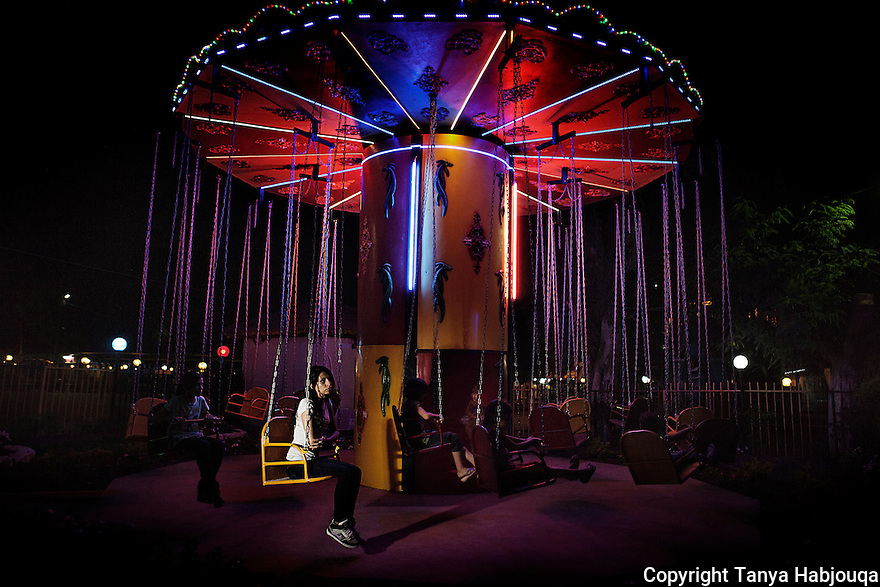 Young theatre actress from Jenin takes a break at a fun fair in Qalqilya, West Bank. 2012