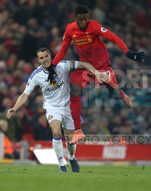 """John O""""Shea of Sunderland and Divock Origi of Liverpool run into each other during the Premier League match at the Anfield Stadium, Liverpool. Picture date: November 26th, 2016. Pic Simon Bellis/Sportimage"""