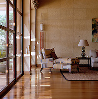 Glazed double doors behind an elegant chaise longue open from the living room on to the terrace