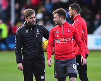 Lincoln City's assistant manager Nicky Cowley, left, during the pre-match warm-up with Lee Frecklington<br /> <br /> Photographer Andrew Vaughan/CameraSport<br /> <br /> The EFL Sky Bet League Two - Cambridge United v Lincoln City - Saturday 29th December 2018  - Abbey Stadium - Cambridge<br /> <br /> World Copyright © 2018 CameraSport. All rights reserved. 43 Linden Ave. Countesthorpe. Leicester. England. LE8 5PG - Tel: +44 (0) 116 277 4147 - admin@camerasport.com - www.camerasport.com