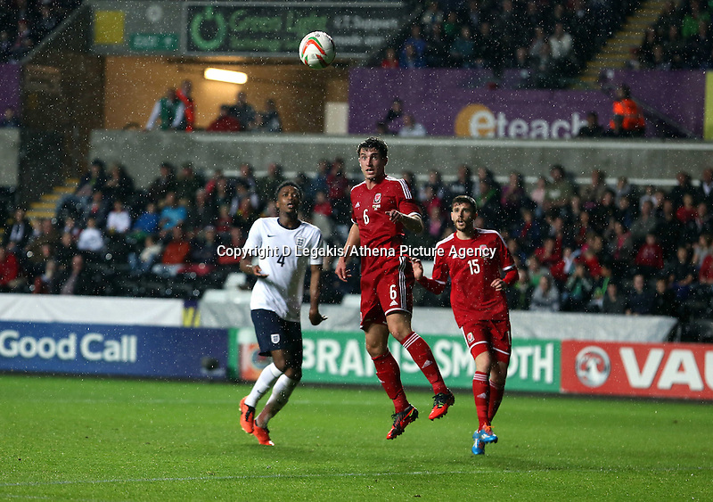 Pictured: Joe Walsh of Wales (C) heads the ball away. Monday 19 May 2014<br /> Re: UEFA Euro Under-21 Qualifier, Wales v England at the Liberty Stadium, Swansea, south Wales, United Kingdom