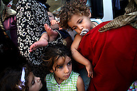 Tyr, Lebanon, Aug 4 2006.Hajj Mariama school (St. Mary), Hundreds of refugees from Shatiyeh, a nearby village heavily bombarded by the Israeli arrived only with the clothes they were wearing as they fleeed their destroyed homes in a hurry.