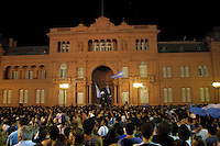 "Thousands of Argentineans gather at Plaza de Mayo, in front of  ""Casa Rosada"" at midnight January 10, 2002, the Argentinean Government House, to demonstrate against the new economic policy, which restricts the withdrawal of the money from personal bank accounts and the devaluation of the peso at about 40%. Photo by Quique Kierszenbaum"