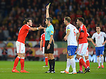 Gareth Bale of Wales gets a yellow card from Referee Alberto Mallenco during the FIFA World Cup Qualifying match at the Cardiff City Stadium, Cardiff. Picture date: November 12th, 2016. Pic Robin Parker/Sportimage