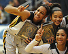Maia Moffitt #12 of St. Anthony's, left, and teammates pose for pictures after their 79-51 win over St. Mary's in the NSCHSAA varsity girls basketball final at Hofstra University on Tuesday, Mar. 1, 2016.