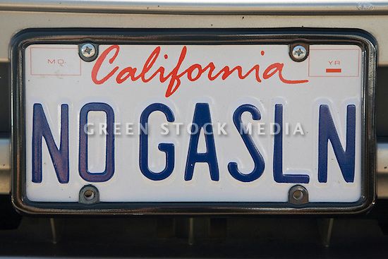 A close up of a 'NO GASLN' (No Gasoline) electric vehicle license plate. At an Electric Vehicle Rally in Palo Alto. Hosted by the Silicon Valley Chapter of the Electric Auto Association. Palo Alto, California, USA